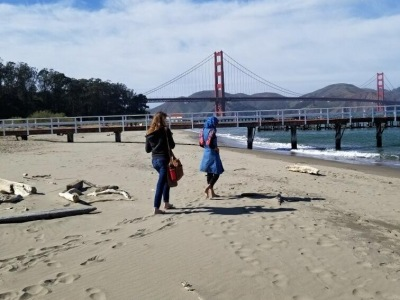 A friend and I walking on the beach in San Francisco