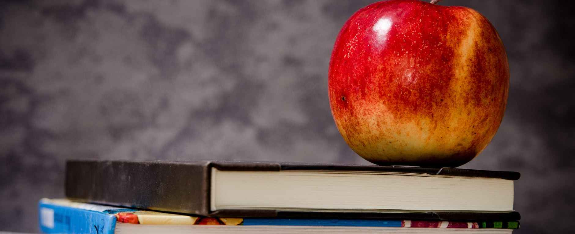 Time for school with books and an apple.